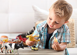child-playing-with-dinosaurs.jpg