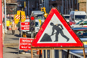 Old Roadworks Sign on a Busy Road in Sco