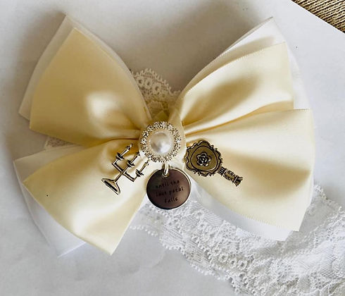 wedding garter with white lace and cream silk bow