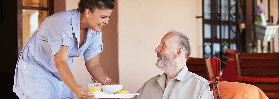 Caregiver talking with residents