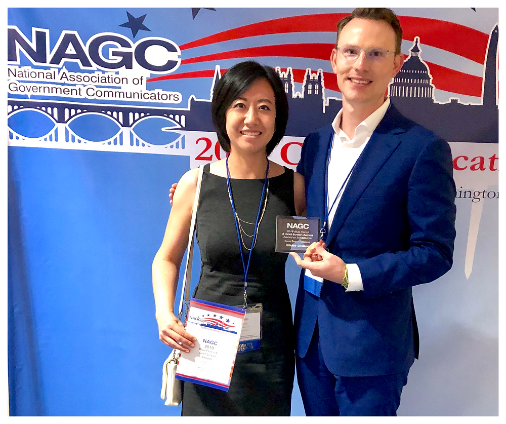 Echo Wang and Alex Emmerman accept the Award of Excellence
