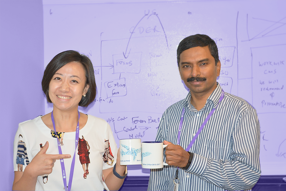 Lead Data Analyst Echo Wang and Director of Enterprise IT Solutions Thiagarajan Prakash, with DATA Act mugs