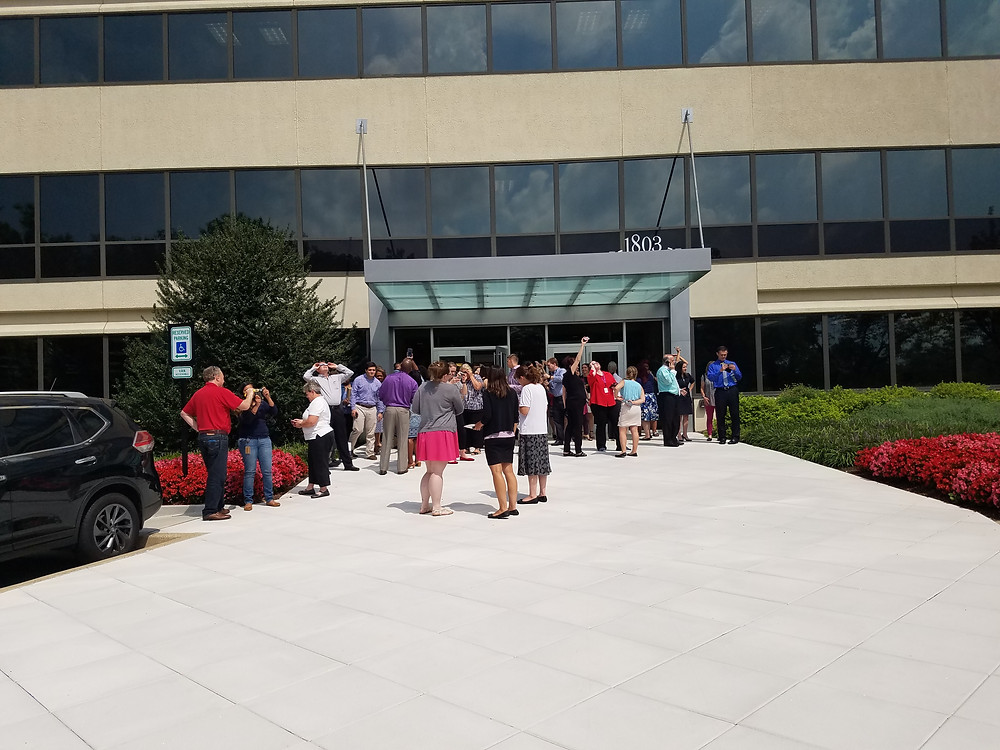 DSFederal employees and 1803 neighbors gather to watch the solar eclipse
