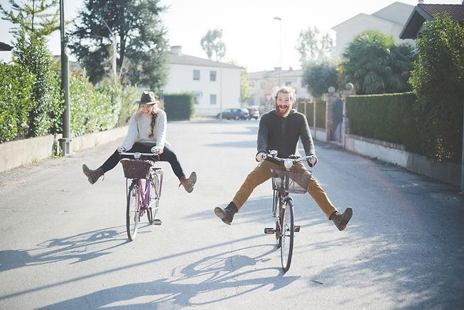 Woman and Man riding bikes