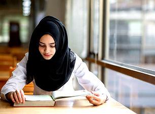 Muslim%252520Girl%252520Studying_edited_