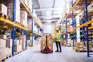Female warehouse worker loading or unloa