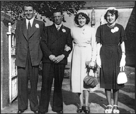 John Joe and Peggy on their wedding day in 1950, flanked by Paddy Bulfin, Best Man, and Sarah Halpin, Bridesmaid.