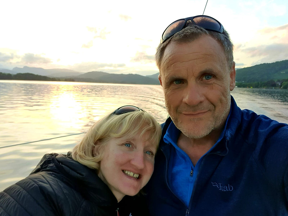 Lucy and Colin with sun setting starting boat deliver in the warm