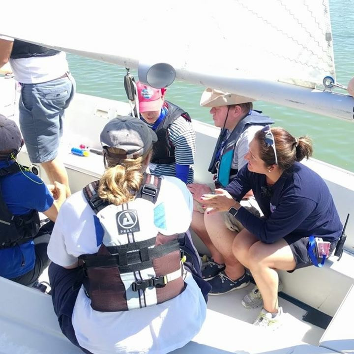 Hannah teaching sail trim from inside the sonar