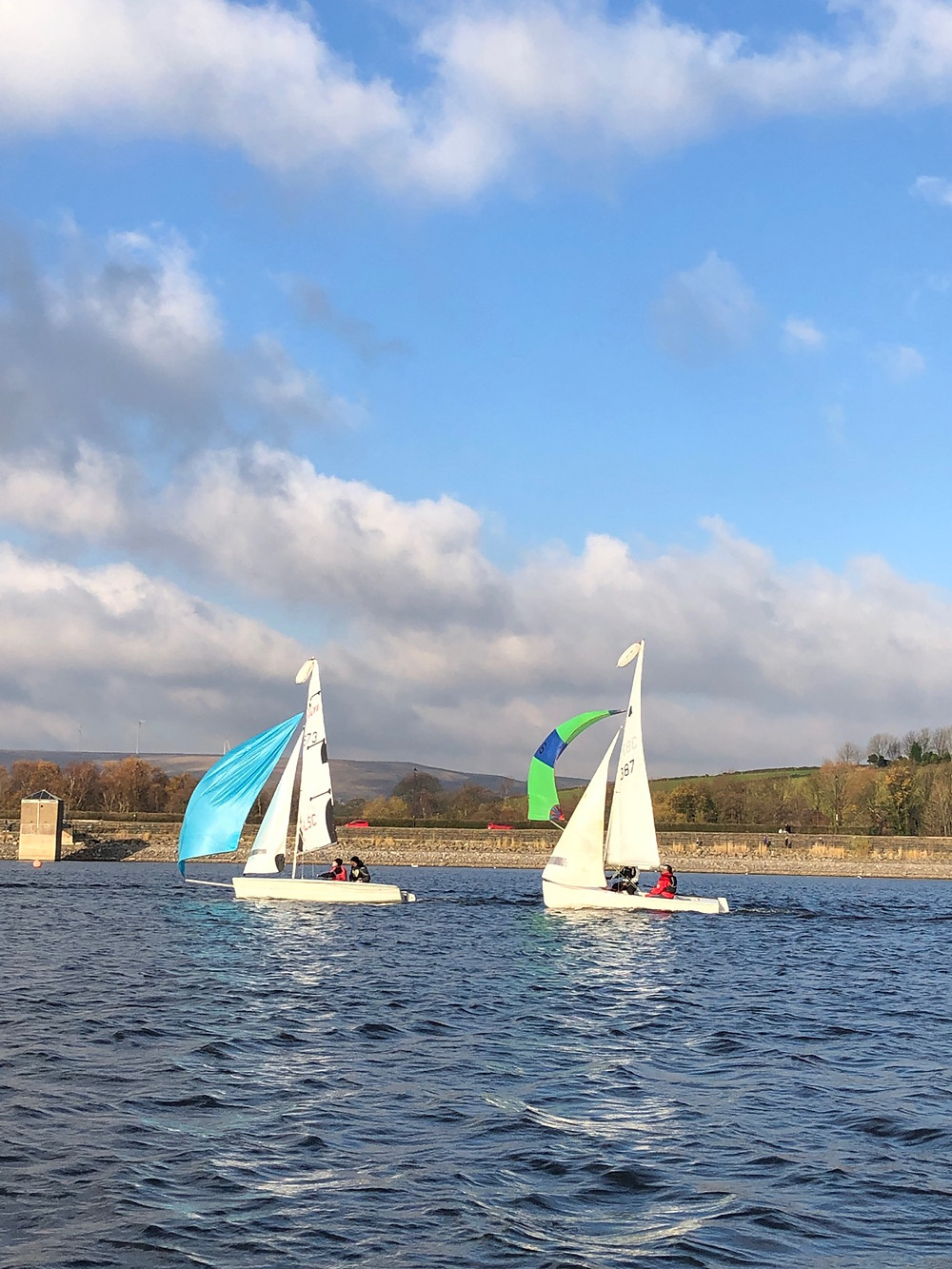 Laser 200 with kite up and GP14 behind with kite up.
