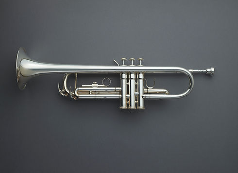 Directly above shot of trumpet against gray background