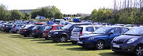 field-car-park-rows-cars-parked-grass-su