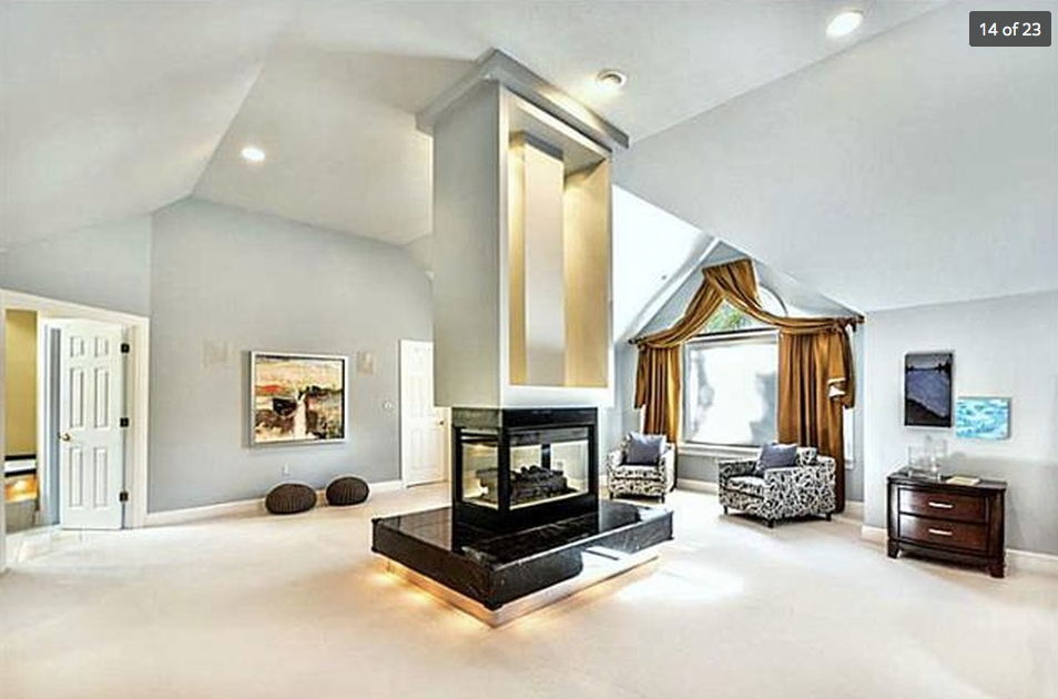Designed to Sell Homes, LLC Fireplace in the center of master bedroom, High End Residential Home Staging.