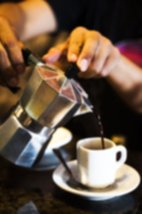 Cuban strong coffee pouring from moka po