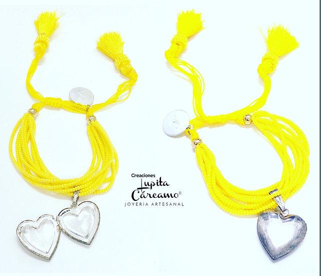 Pulso corazon amarillo ( relicario)