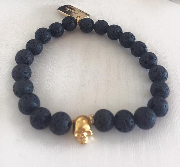 pulsera de piedra de lava con conector de craneoen chapa de oro