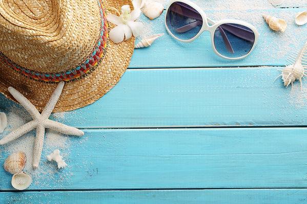 beach accessories on wooden board.jpg