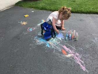 granddaughter chalk the walk.JPG