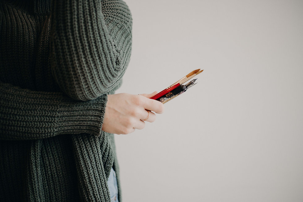 under arm holding pens.jpg
