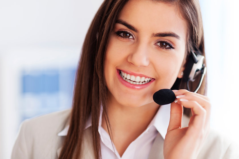 happy-female-wearing-headset-and-looking