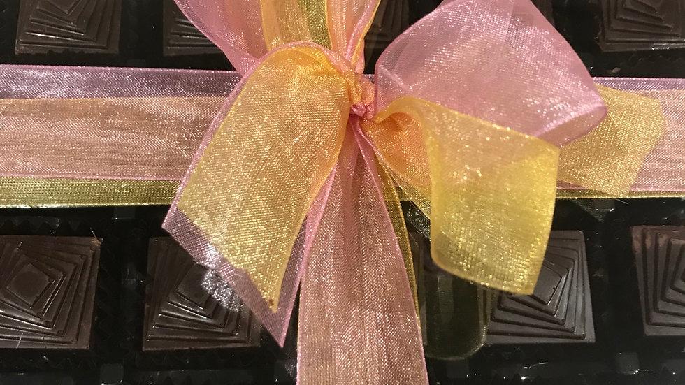 Marzipan squares covered in dark Chocolate 72% single origin from Ecuador.