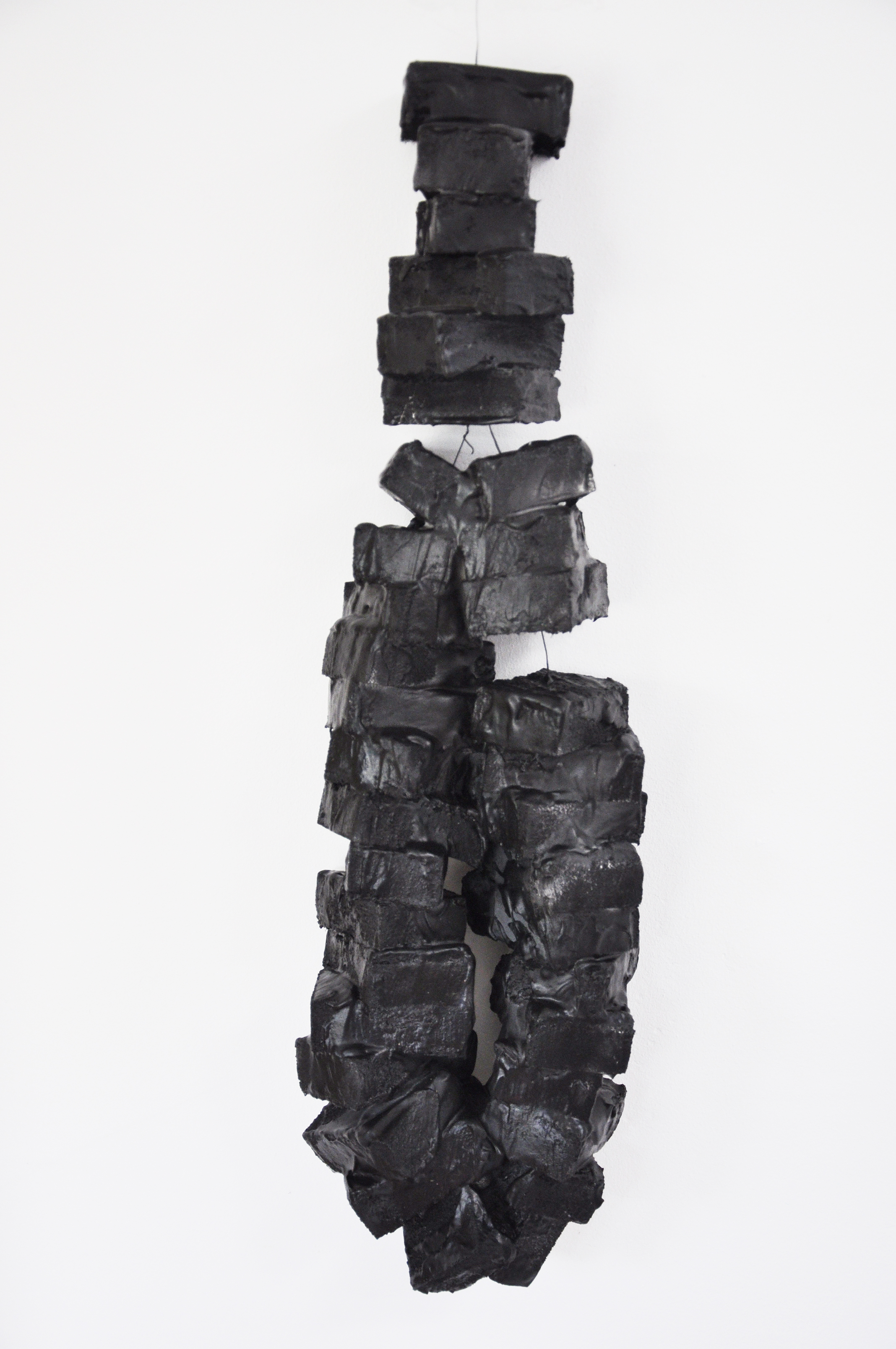 Black Blocks of Sensations, iron, paint, plaster, plastic, Ca 80 x 21 x 12 cm, 2009