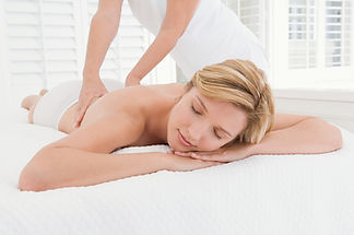relaxed woman being massaged by therapist