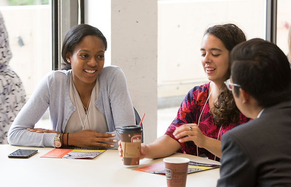 Three Nonprofit Lab attendees share experiences at a table.