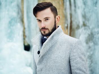 outdoor-portrait-of-handsome-man-in-gray