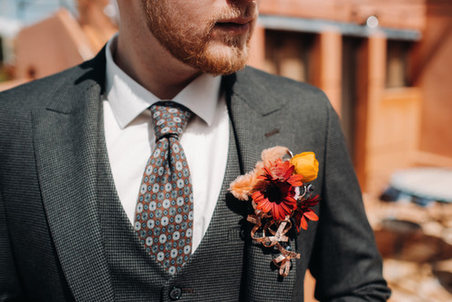 groom-in-a-jacket-and-boutonniere-close-