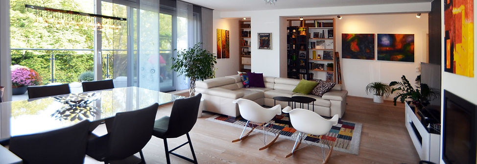 Modern living room with modern and colorful interior. Eames chairs. Eclectic Ethno Interior Design