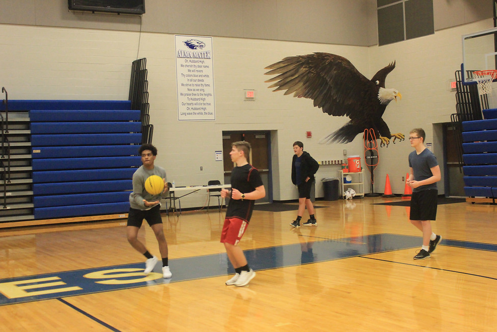 Students play Hooverball during HHS PE class
