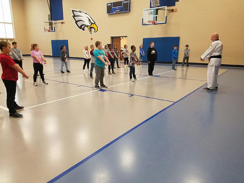 Master Ritchie teaches students Taekwondo.