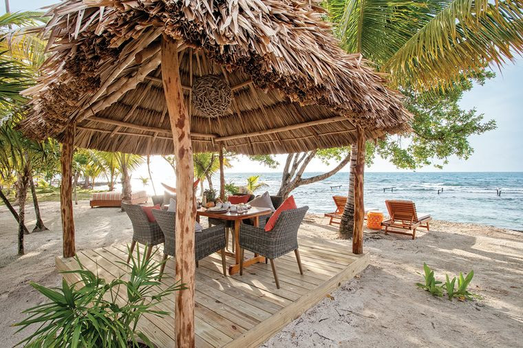Beach palapa with table and chairs, and view of the beach