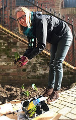 02.19 Y Lou planting summer bulbs to attract bees and butterflies.jpg