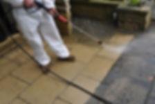 Man pressure washing