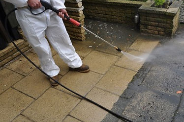 Man pressure washing