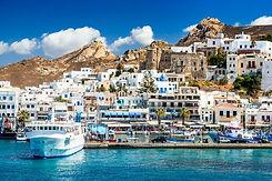 Naxos-island-port-boat-and-white-houses.