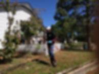 Randy spraying a yard