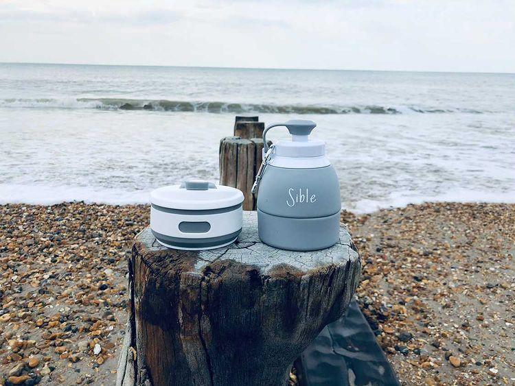 Water bottle on a beach, sea in background