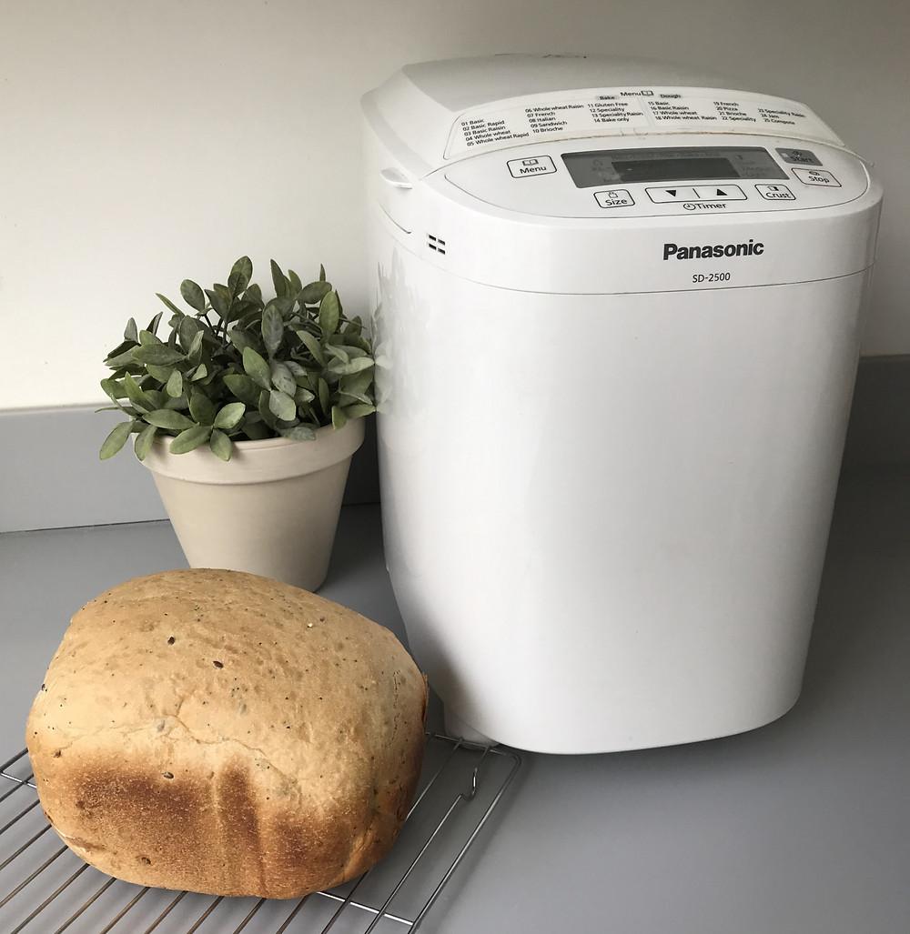 Panasonic bread maker, loaf of bread, plant