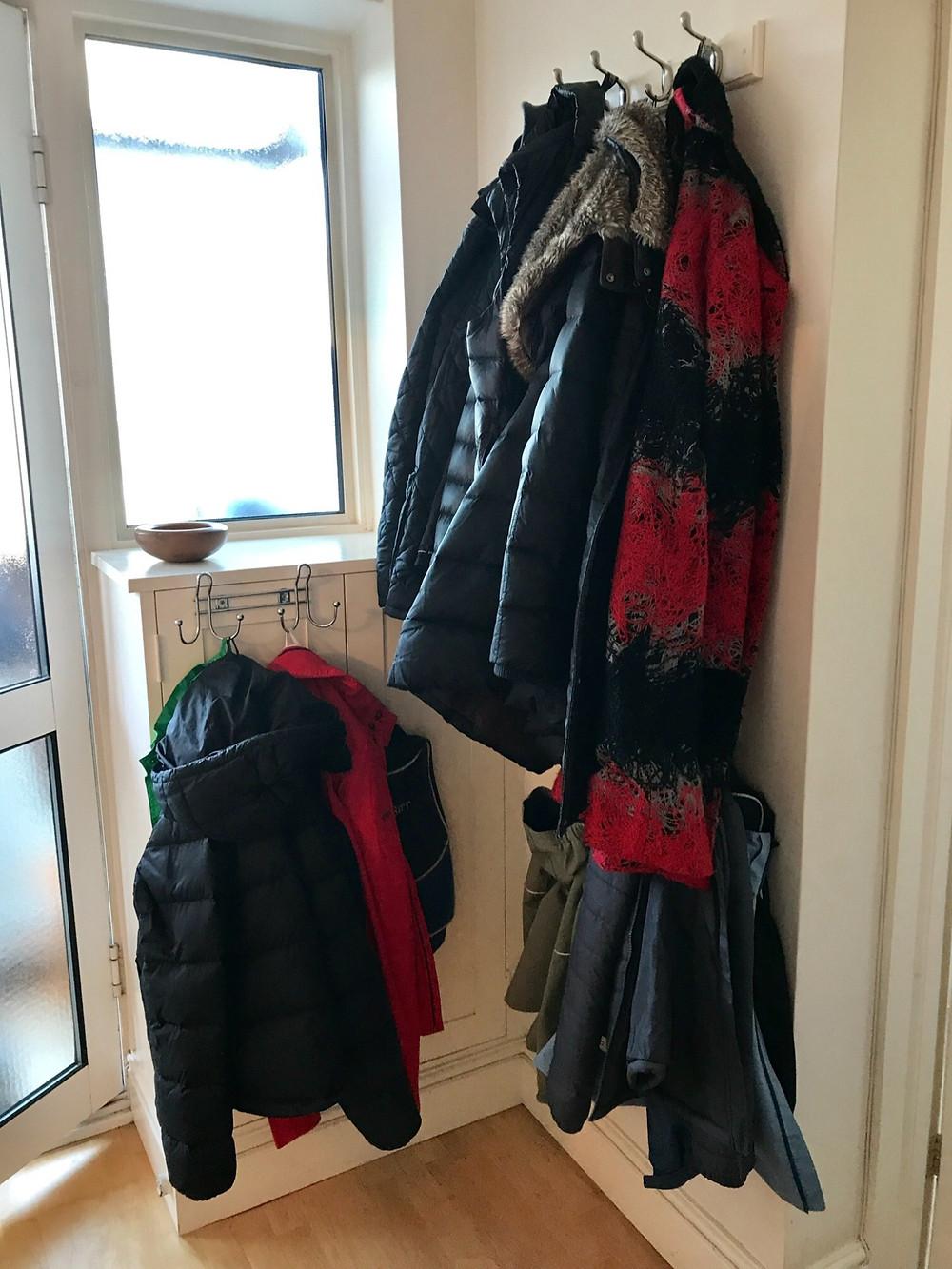 Coats hanging in hallway, entrance storage