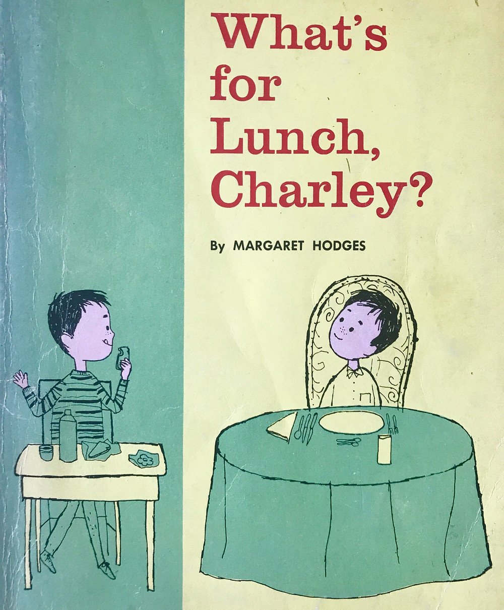 two boys one sitting at a school desk with packed lunch, the other at a fancy restaurant table