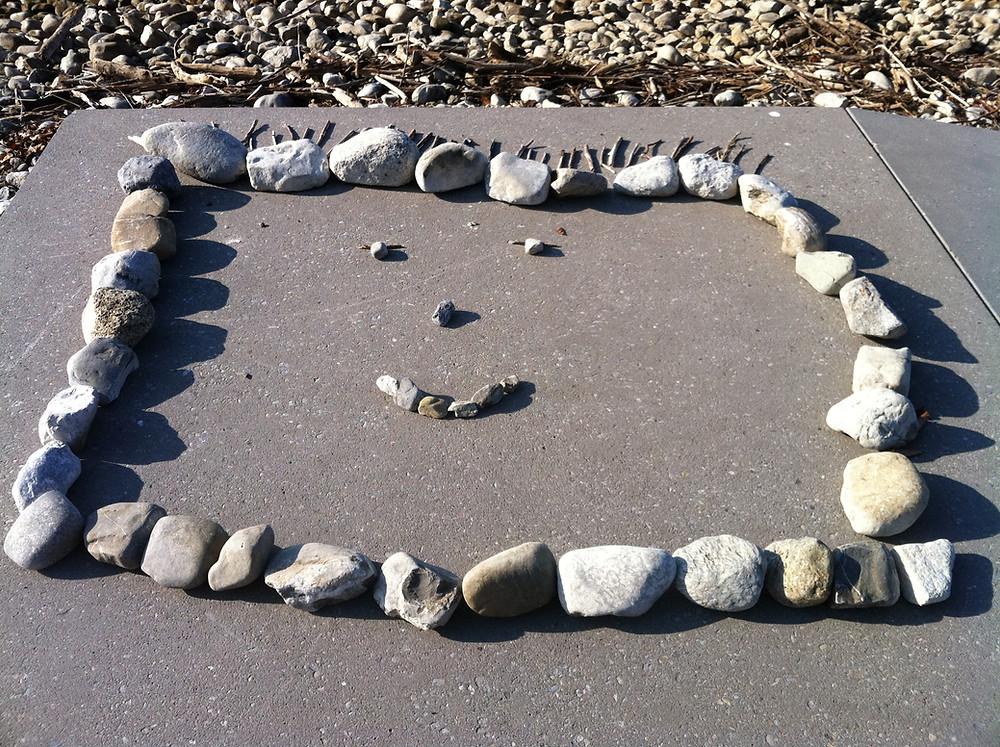 nature rocks stones beach smiley face pebble art