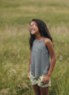 candid moment of little girl laughing by twin cities children photographer