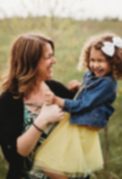 mom and daughter langhing by Twin Cities family photographer