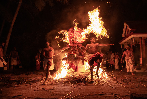 Travel photographer Runa Lindberg captures performers dancing in fire at the Theyyam Festival in Kerala, South India