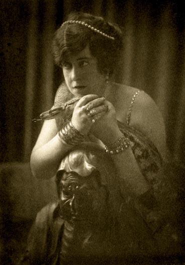Aimée Crocke, American socialite, and her pet snake, Kaa