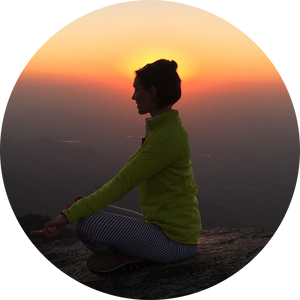 Yoga studio owner poses in the mountains