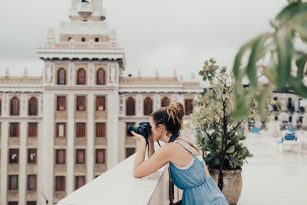 A female travel photographer in Havana, Cuba